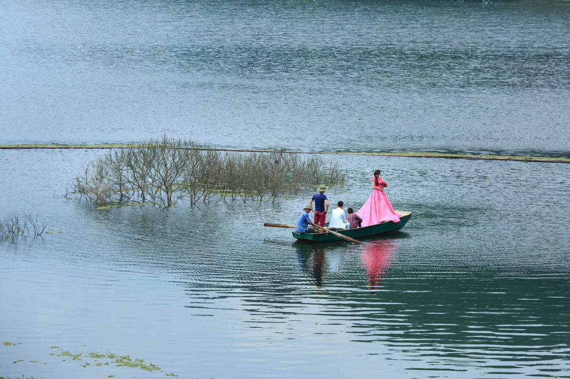 Lao Cai province, Vietnam - September 28, 2016: A wedding shooting day when bride and groom are on a wild lake. This place has beautiful views which married couples always shoot here Bridal Marriage  Asian  Beautiful Bride Camera Couple Eternal Fashion Fiancee Forever Frame Groom Happy Interesting Lake Love Male Marry Newlywed Photography Village Wedded Wedding Young