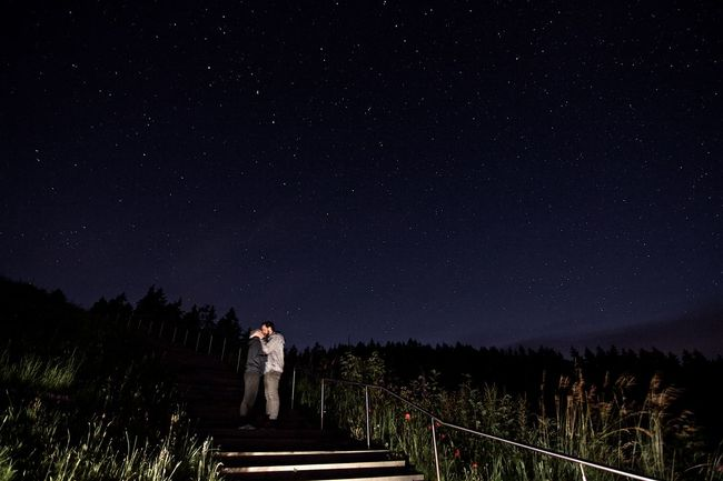 Beauty In Nature Boardwalk Couple Dark Footpath Full Length Kissing Nature Night Outdoors Rear View Scenics Sky Solitude Stairs Star - Space Star Field Steps The Way Forward Togetherness Tranquil Scene Tranquility Tree Walking Wide Angle