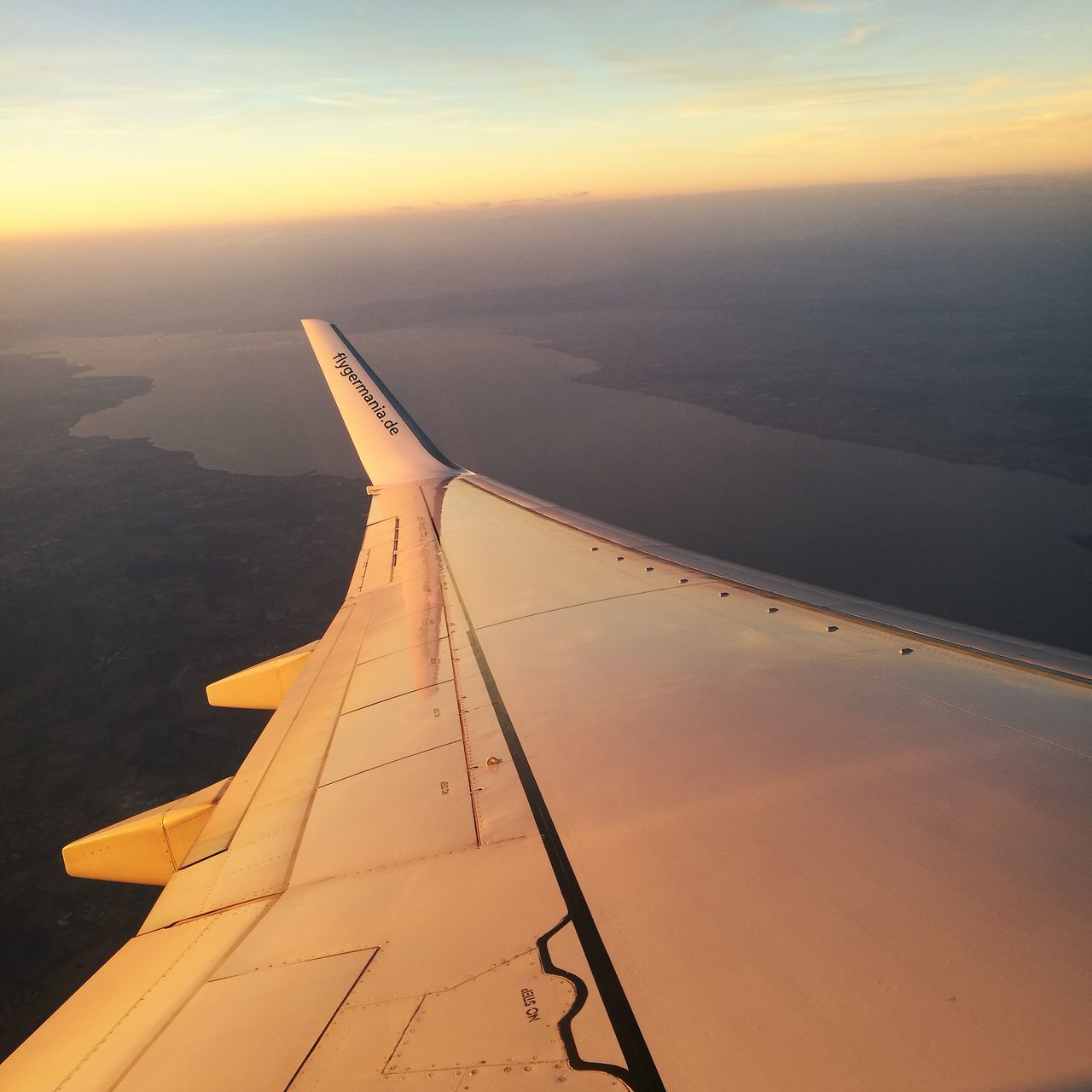 airplane, aerial view, journey, transportation, airplane wing, travel, aircraft wing, scenics, mode of transport, nature, flying, air vehicle, beauty in nature, no people, sunset, sky, cloudscape, outdoors, cloud - sky, mid-air, water, tranquil scene, tranquility, sea, vehicle part, landscape, day, jet engine, the natural world, close-up
