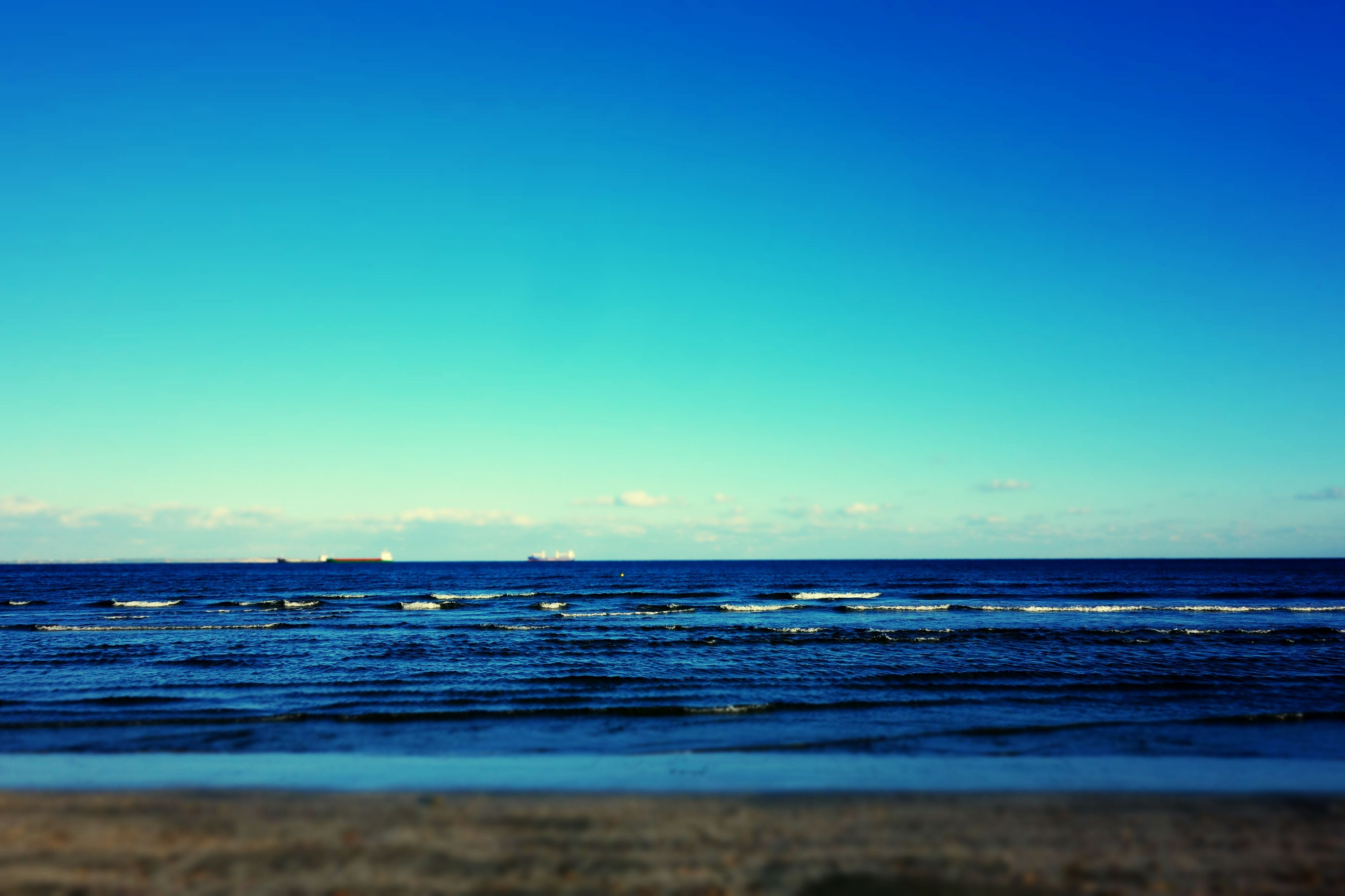 sea, water, horizon over water, beauty in nature, blue, nature, tranquility, scenics, tranquil scene, beach, clear sky, no people, sky, outdoors, day