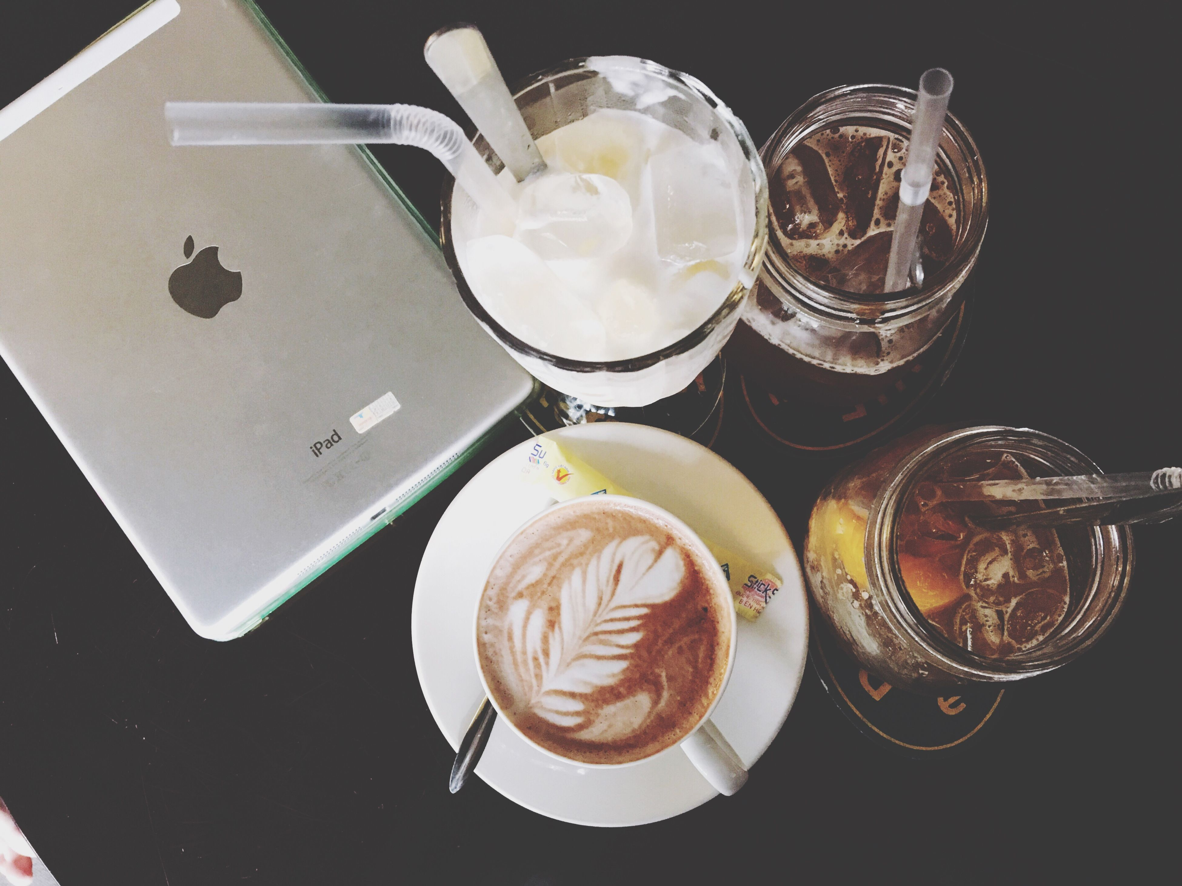 food and drink, indoors, still life, table, sweet food, plate, food, freshness, dessert, spoon, indulgence, ready-to-eat, high angle view, drink, unhealthy eating, refreshment, coffee cup, saucer, serving size, cake