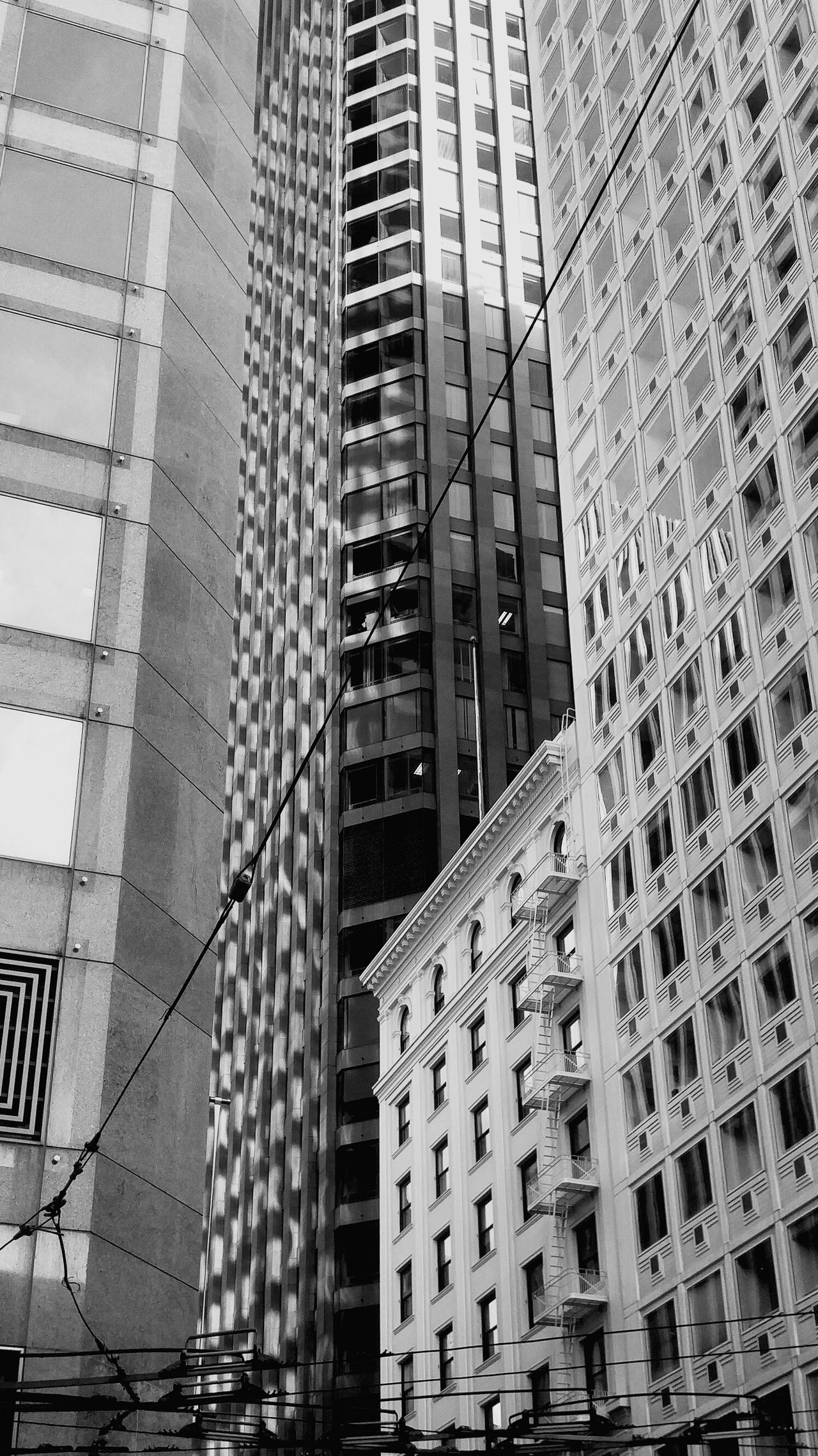 Architecture Building Exterior Built Structure City No People Pattern Travel Destinations Day Outdoors Skyscraper Landscape San Francisco Urban Geometry Urban Landscape Backgrounds Low Angle View Architecture City City Life Building Glass Unique Perspectives Unique