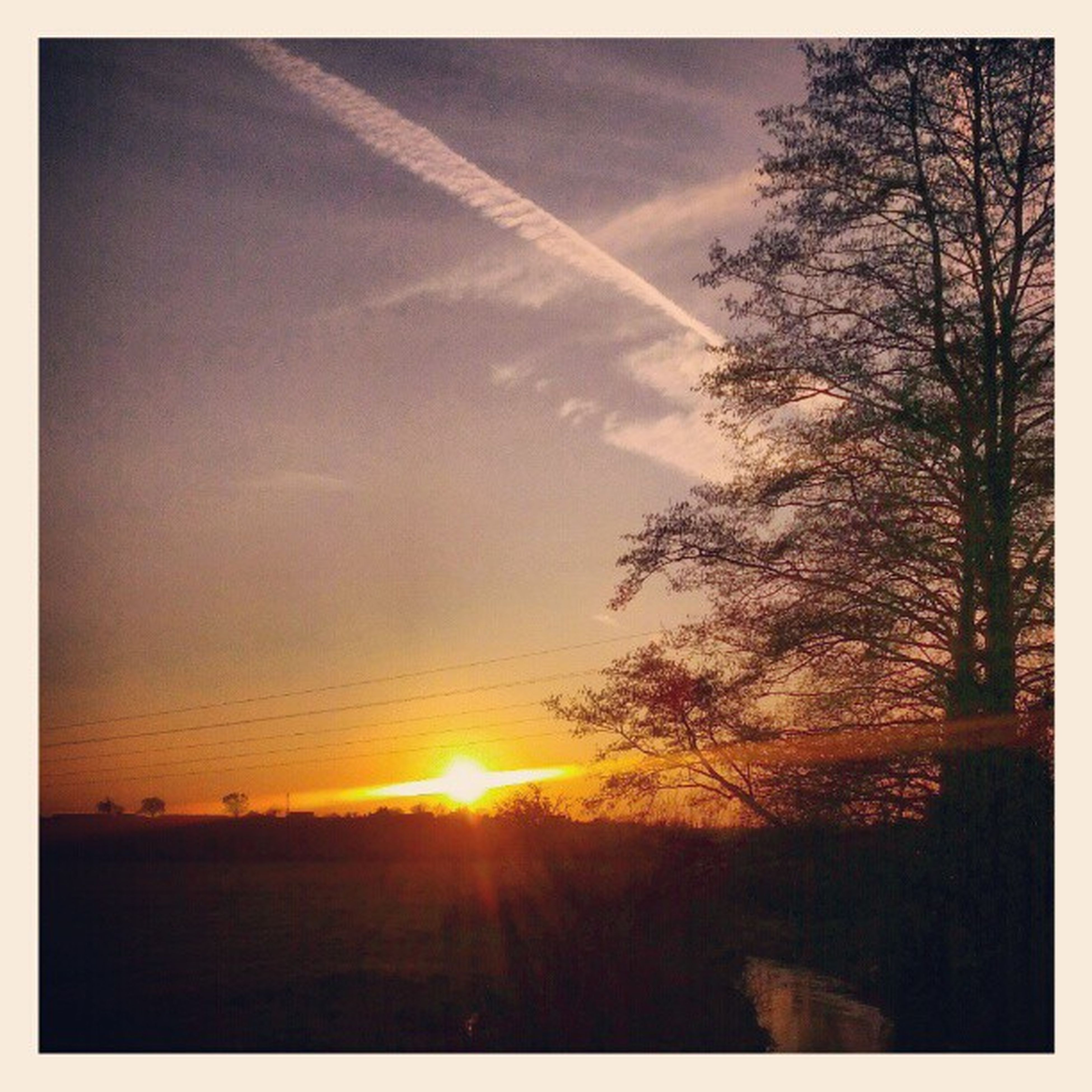 sunset, transfer print, sun, sky, tranquility, scenics, tranquil scene, beauty in nature, tree, silhouette, auto post production filter, sunlight, nature, sunbeam, cloud - sky, idyllic, orange color, cloud, outdoors, lens flare