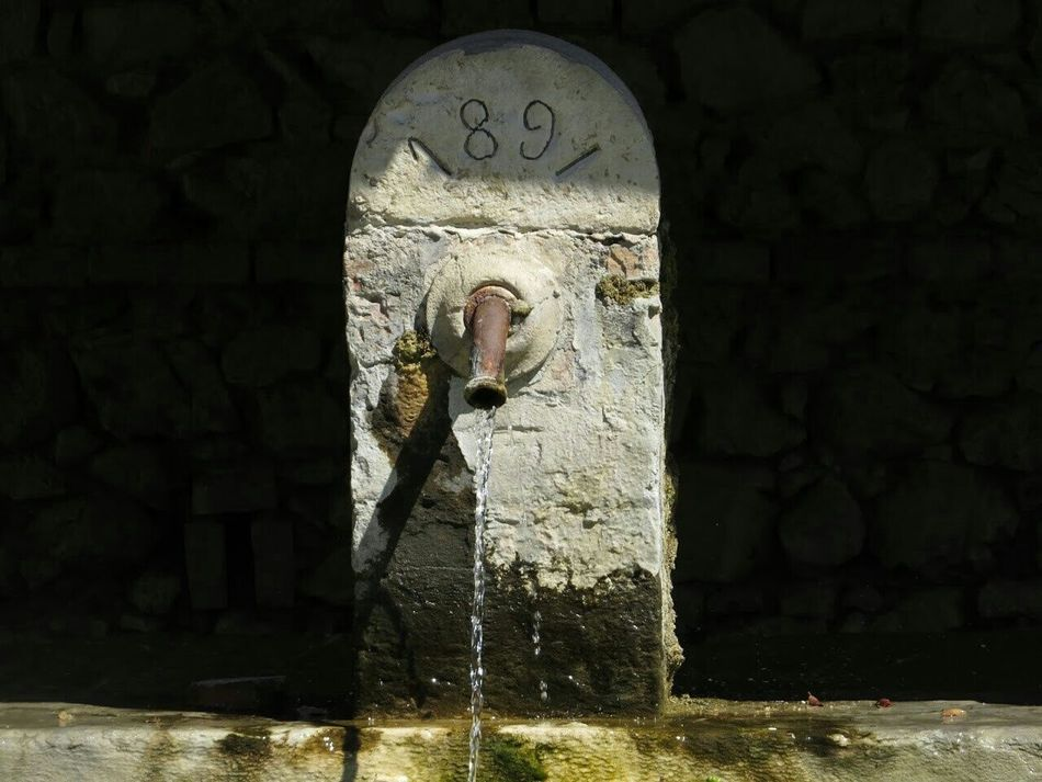 The Flow Of Time and Water. Water Fountain between Light And Shadow , Central Italy , HistoryAlive in an Old Village