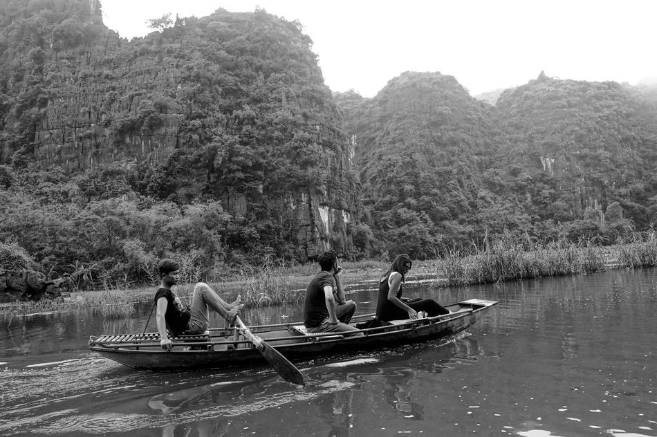 Beauty In Nature Boat Day Leisure Activity Men Mode Of Transport Moored Mountain Nature Nautical Vessel Oar Outdoors Real People River Rowboat Rowing Scenics Sitting Tranquil Scene Tranquility Transportation Tree Water Waterfront Women