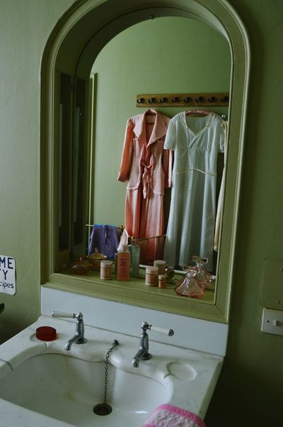 Bathroom 1940s Period Clothes Second World War Historical Building Reflection Mirror Perfume Toiletries Ladies Fashion