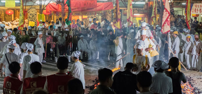 Visitors and Taoist devotees at the Nine Emperor Festival in a Taoist temple in Kuala Lumpur Malaysia Celebrate Ceremony Chinese Colorful Crowd Deity Devotees Emperor Fire Jossstick Malaysia Nine Nine Emperor Festival People Religious  Shrine Taoist Temple Walking
