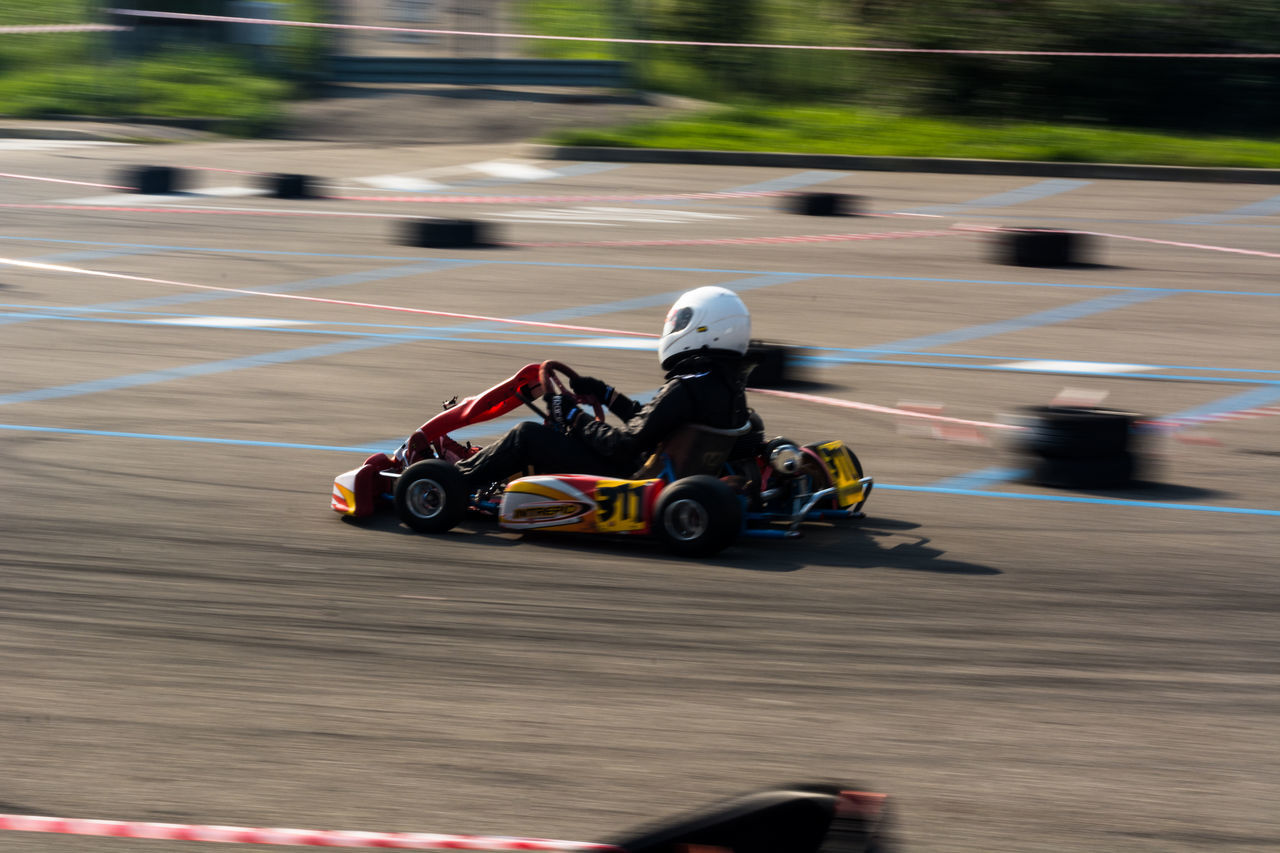 kart panning Adventure Auto Racing Blurred Motion Children Only Competition Crash Helmet Day Driving Headwear Helmet Motion Motor Racing Track Motorcycle Racing Motorsport One Boy Only One Person Outdoors People Racecar Speed Sport Sports Helmet Sports Race Sports Track