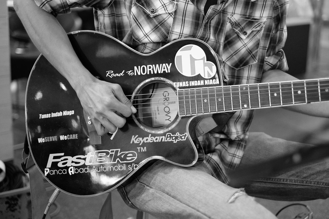TakeoverMusic Guitar Plucking An Instrument Music One Person Midsection My Year My View Streetphotography Street Photography Streetphoto_bw Guitarist Electric Guitar One Man Only Adults Only Playing Arts Culture And Entertainment People Skill  Musical Instrument Musician Close-up Rock Music Men Only Men Adult
