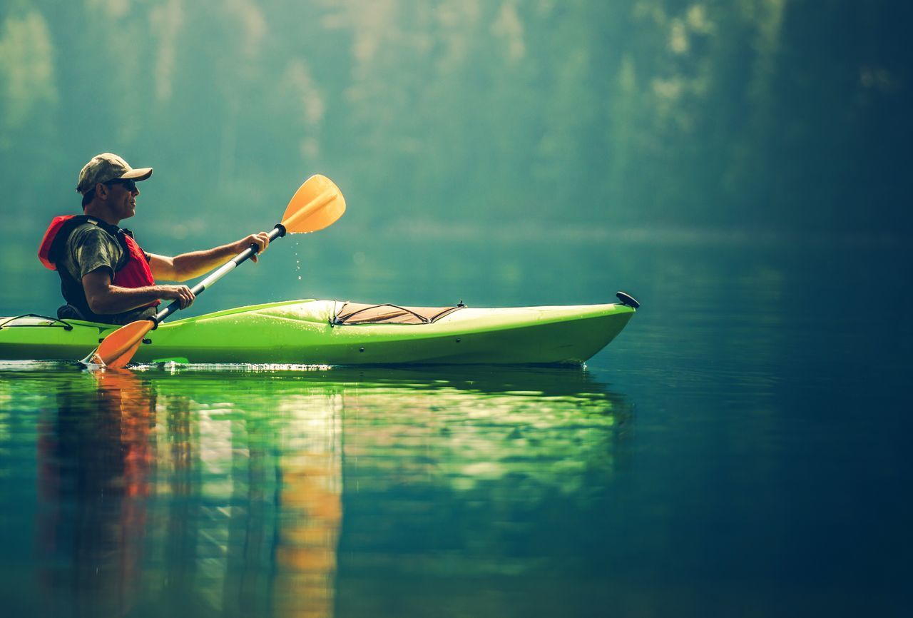 oar, water, lake, paddling, waterfront, leisure activity, one person, vacations, kayak, nature, day, adventure, outdoors, real people, nautical vessel, rowing, floating on water, women, paddleboarding, sitting, beauty in nature, tree, people