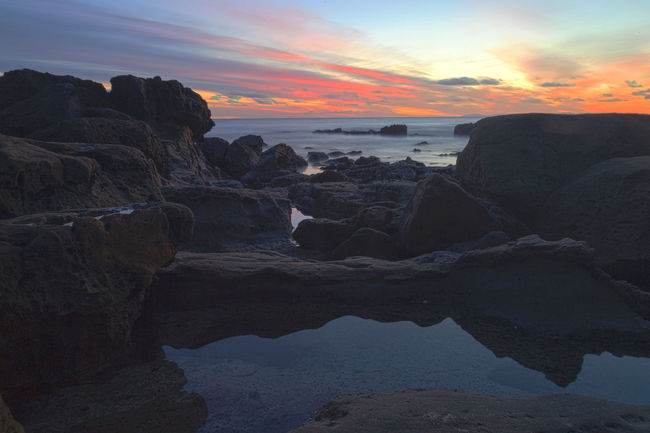 Sunset over Diver's Cove in Laguna Beach, California, United States Beach Beauty In Nature Coastal Coastline Coastline Landscape Divers Cove Horizontal Laguna Beach, CA Nature No People Ocean Outdoors Panorama Panoramic Rocks Scenics Sea Sky Sunset Sunset And Clouds