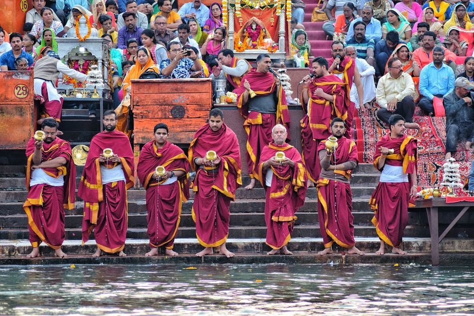 """Haridwar...during """"Arti"""".. Multi Colored Outdoors Travel Destinations Water Day Variation Vibrant Color India Joy And Enlightenment Patriotism Haridwar,India Ganga River Holywater  People And Nature Real People Arti Indian Sunset"""
