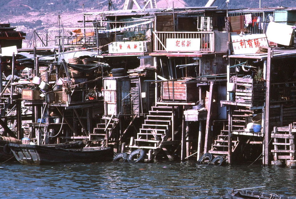 Fishermen's Housing (1980), Kowloon Bamboo Buildings Bamboo Housing Built Structures Capital City China Composition Fishermen Fishermens Shack Fishermenvillage Full Frame Hong Kong Housing Settlement Kowloon No People Outdoor Photography Residential District Ripples In The Water Slums Steps Sunlight Tourism Tourist Attraction  Tourist Destination Unusual Water
