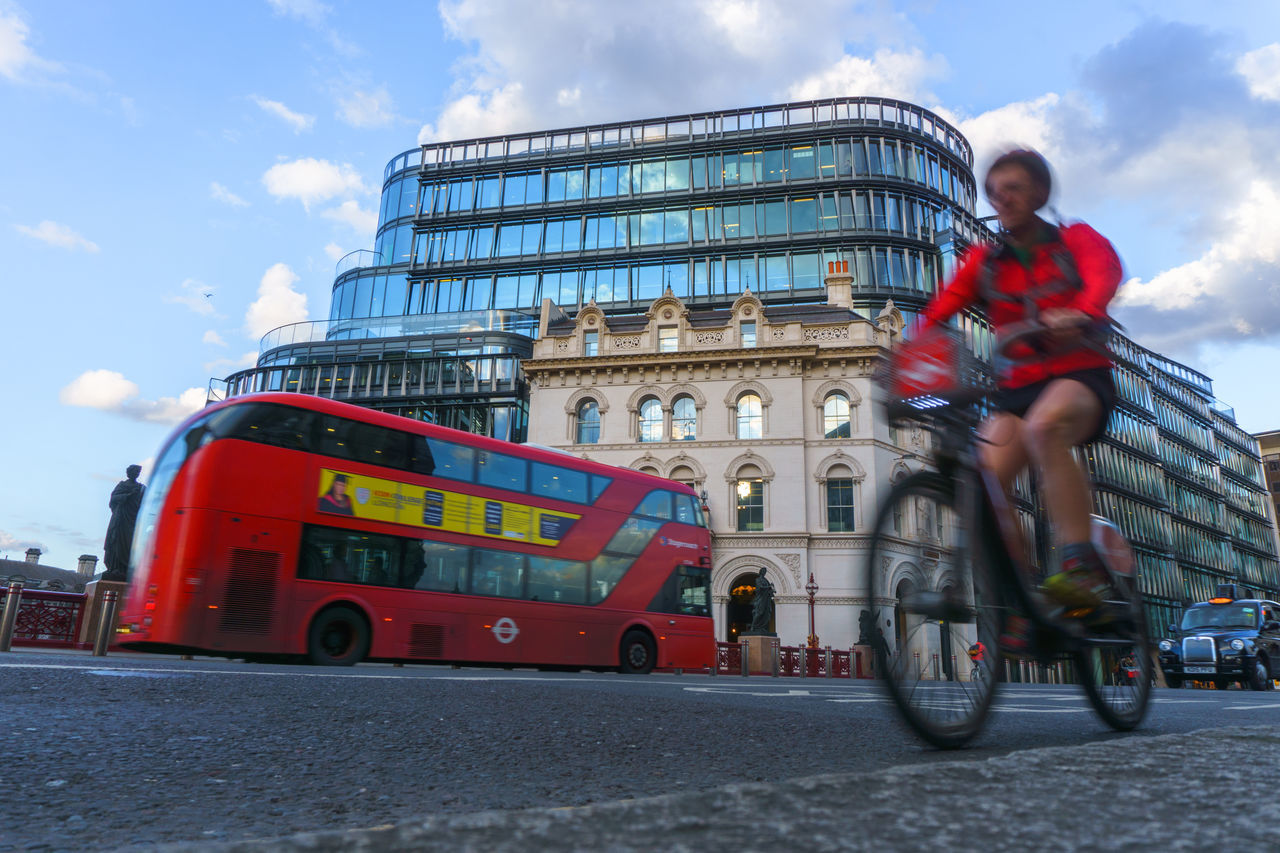 Architecture Building Exterior Built Structure Bus Capture The Moment capturing motion City Cycling CyclingUnites Cyclist Day Headwear Holborn Viaduct London Lifestyle Low Angle View Mode Of Transport Motion One Person Outdoors Protective Workwear Red Sky Transportation Travel Destinations