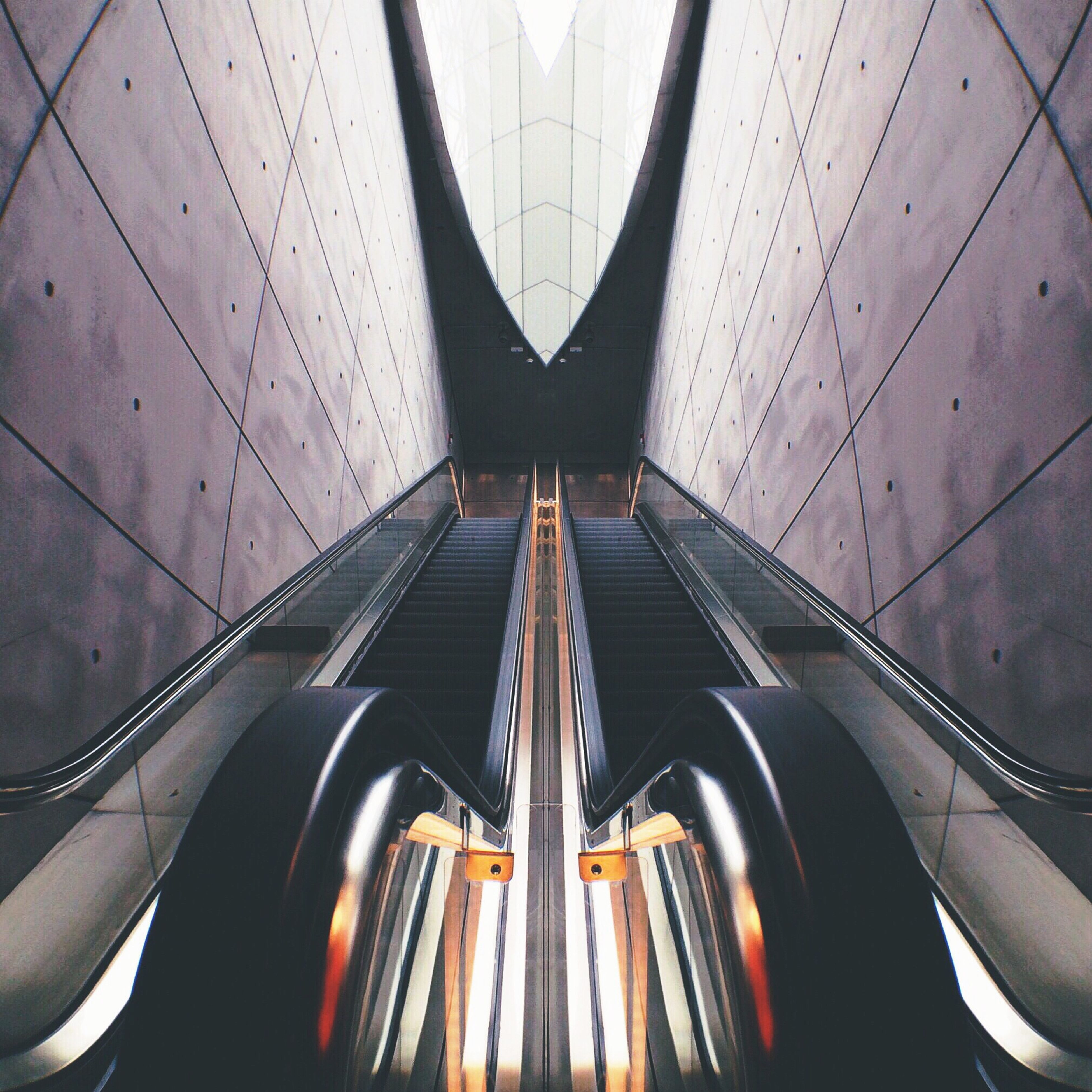 transportation, indoors, mode of transport, diminishing perspective, architecture, the way forward, built structure, land vehicle, modern, vanishing point, car, low angle view, no people, pattern, vehicle interior, travel, part of, escalator, glass - material, day