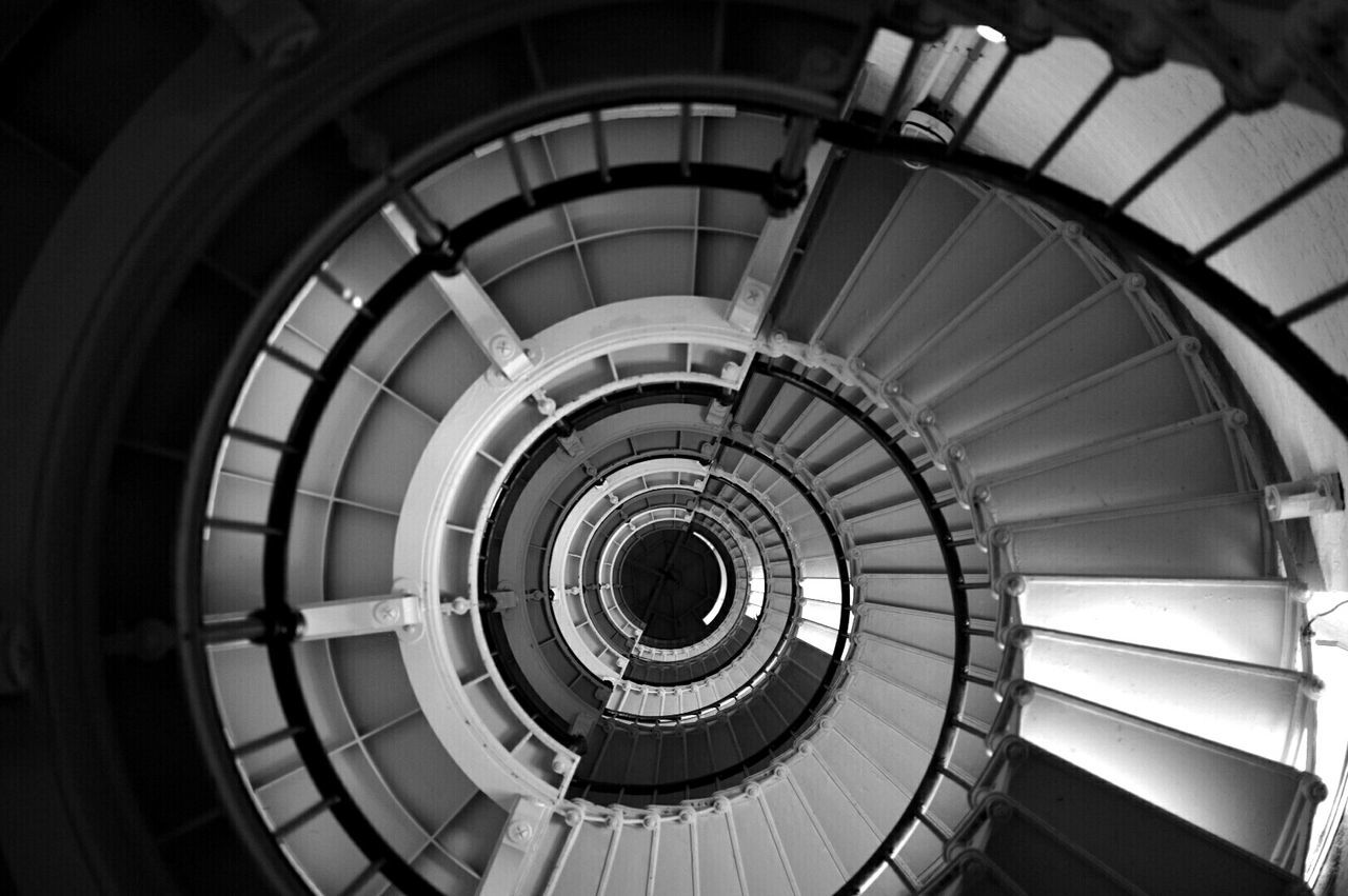 Directly Below Shot Of Spiral Staircases In Lighthouse