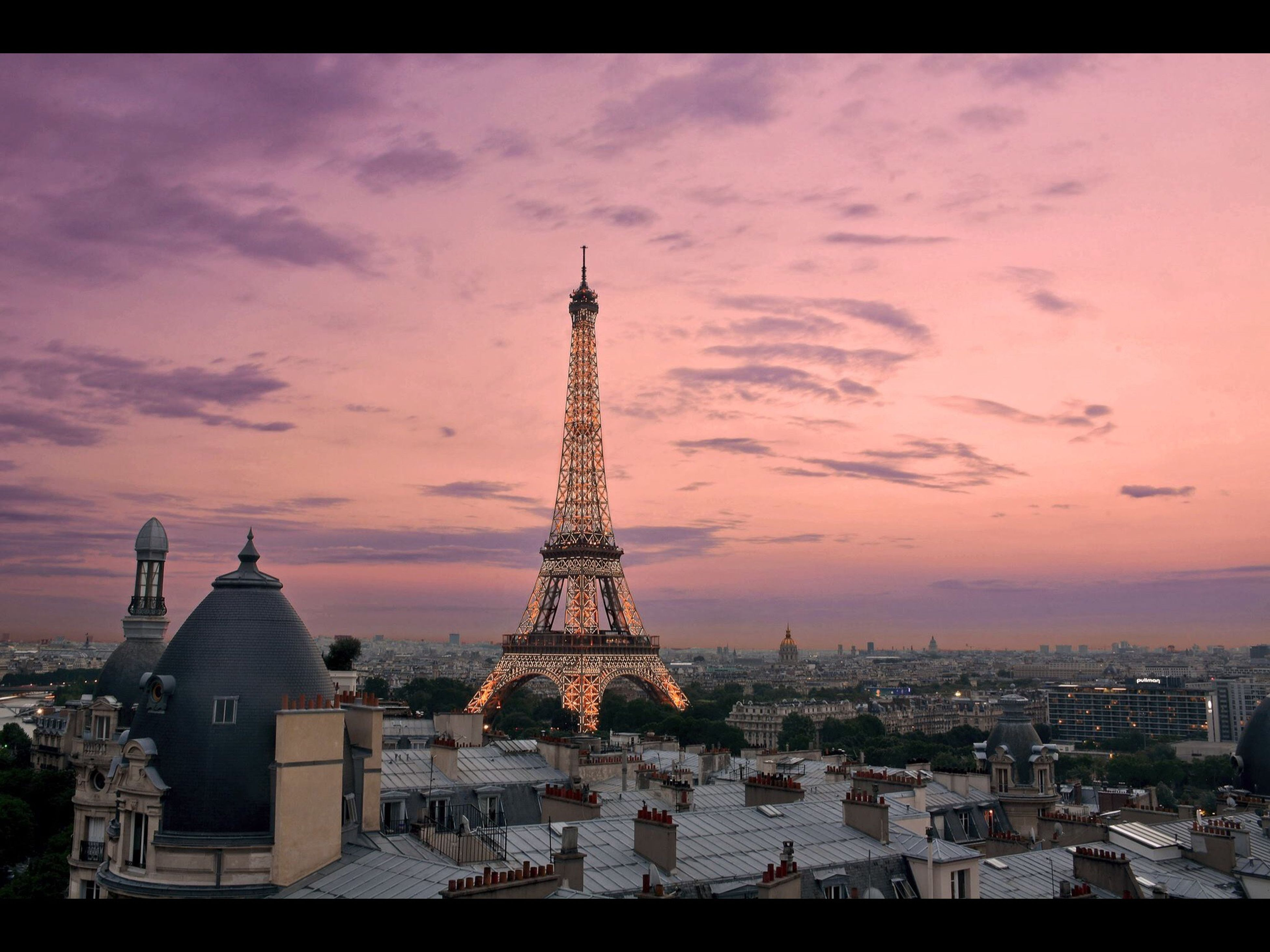 built structure, architecture, eiffel tower, tourism, travel destinations, city, tower, building exterior, international landmark, culture, famous place, capital cities, travel, tall - high, auto post production filter, cityscape, dusk, crowded, residential structure, residential building, sky, architectural feature, city life, spire, cloud - sky, cloud, town, residential district, no people, outdoors, arch