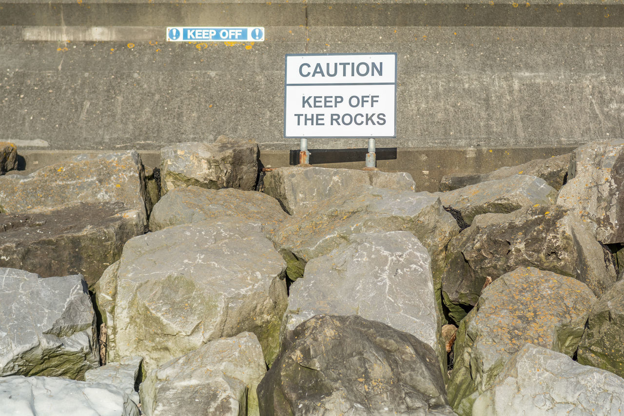 Keep off the rocks Beach Communication Day Keep Off Sign Keep Off The Rocks No People Outdoors Rocks Text
