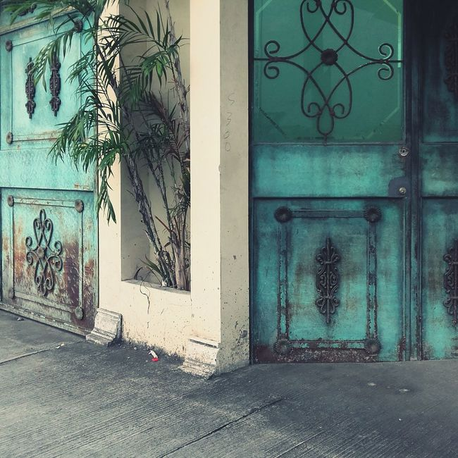 Abandoned house facade Facades House Abandoned Places Abandoned House Decadence Nobody Home Style Turquoise Colored Iron Deco Decorated Doors