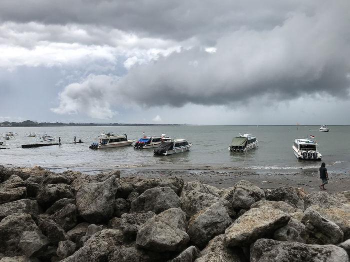Bali, Indonesia Beach Beauty In Nature Cloud - Sky Day Horizon Over Water Mode Of Transport Moored Nature Nautical Vessel No People Outdoors Rock - Object Scenics Sea Shore Sky Storm Cloud Tranquil Scene Tranquility Transportation Water