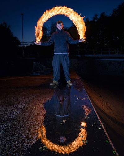 Night One Person Real People Burning Flame Front View Standing Illuminated Outdoors Full Length Young Adult Young Women Sky Adult People