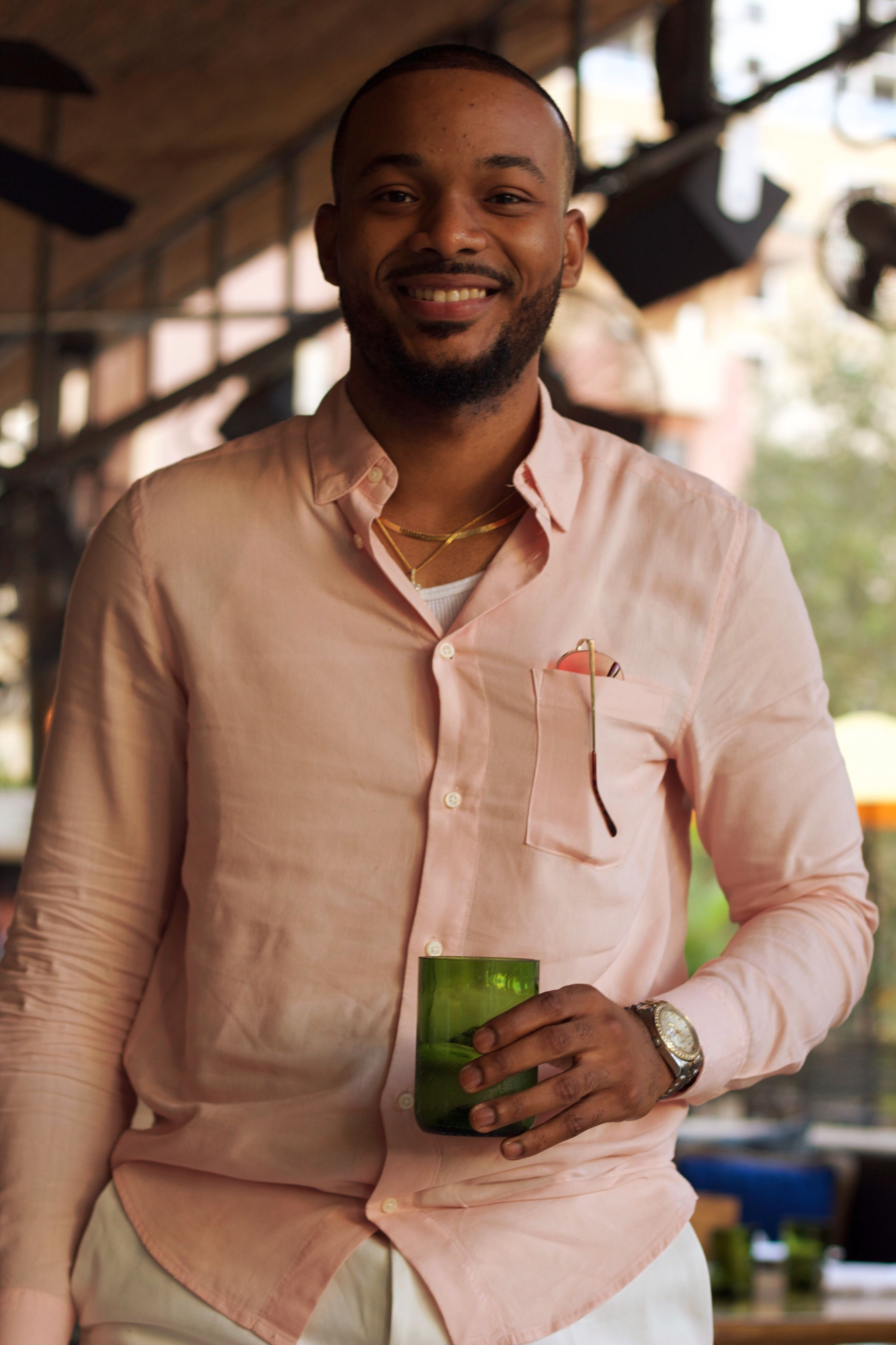 only men, one man only, adults only, handsome, men, one young man only, fashion, adult, portrait, beautiful people, young adult, one person, people, smiling, bar - drink establishment, alcohol, drink, happiness, cheerful, happy hour, macho, close-up, outdoors, day