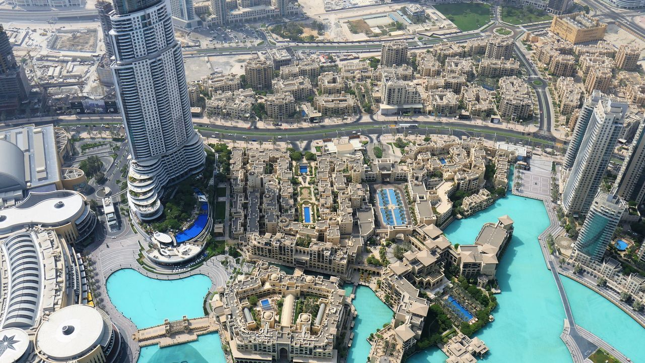 architecture, building exterior, cityscape, built structure, high angle view, city, skyscraper, aerial view, no people, outdoors, travel destinations, river, day, modern, water