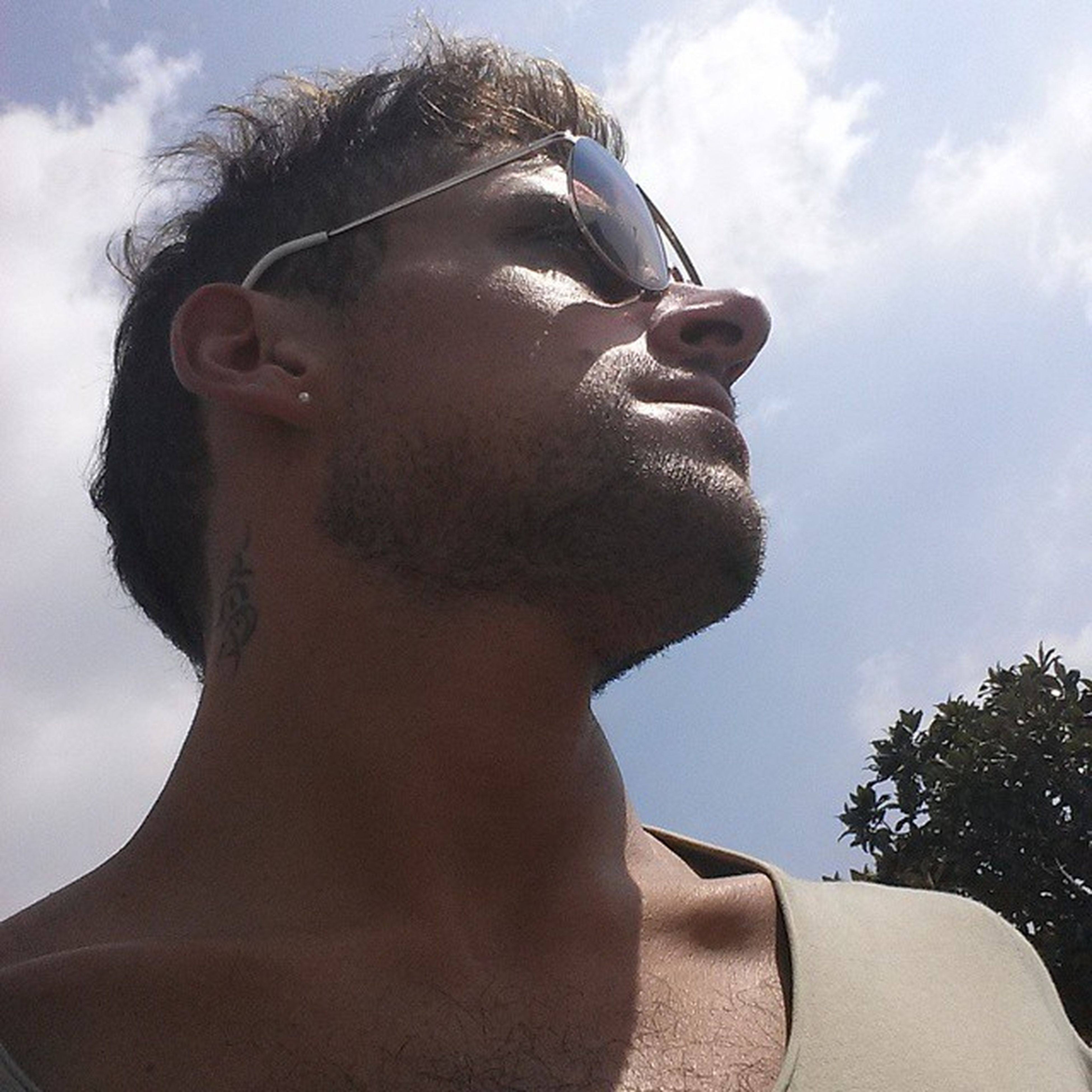 young adult, person, headshot, portrait, sky, looking at camera, young men, lifestyles, sunglasses, mid adult, leisure activity, front view, beard, mid adult men, close-up, head and shoulders