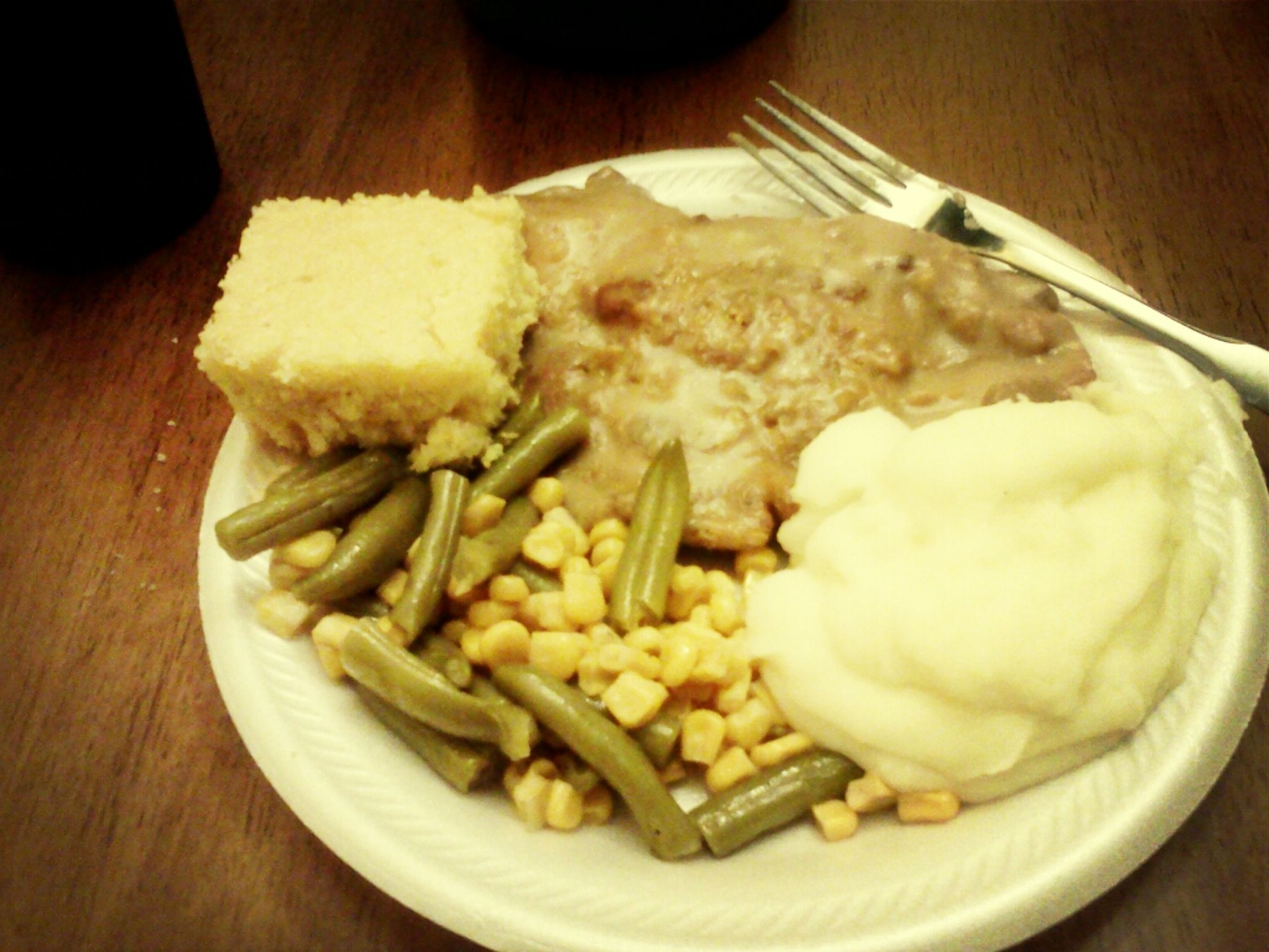 Dinner for tonight . Pork chops smuthered in gravy , mashed potateos , corn & green beans , & cornbread ! #delicious