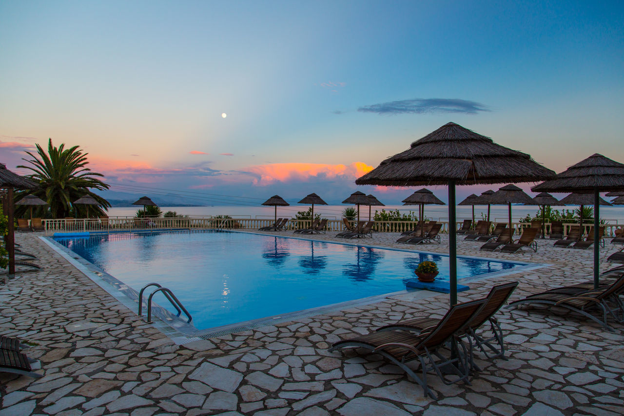 Beauty In Nature Blue Calm Daylight Daytime Greece Korfu Nature Outdoors Palm Tree Pool Poolside Reflection Scenics Sky Summer Views Summertime Sunset Sunshade Tourism Tourist Resort Water