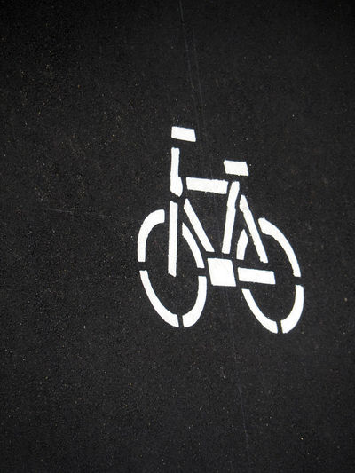 Bicycle Bicycles Bike Black Color Close-up Cycling Directional Sign Guidance Information Information Sign Marking Marking Of Road No People Outdoors Parking Parking Lot Road Road Marking Road Sign Sign Text
