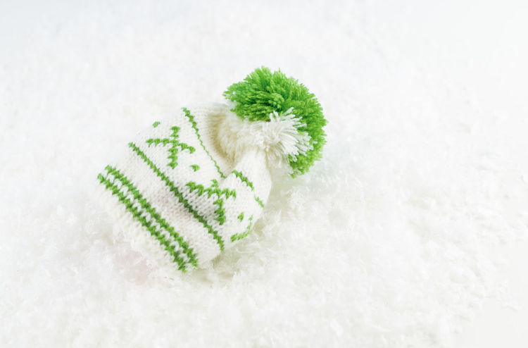 Christmas Christmas Time EyeEmNewHere The Week On EyeEm Bobble Bobble Hat  Cap Christmas Close-up Cold Temperature Day Freshness Green Color Indoors  Nature No People Snow Snowflake Studio Shot Warm Clothing White Background White Color Winter Wool
