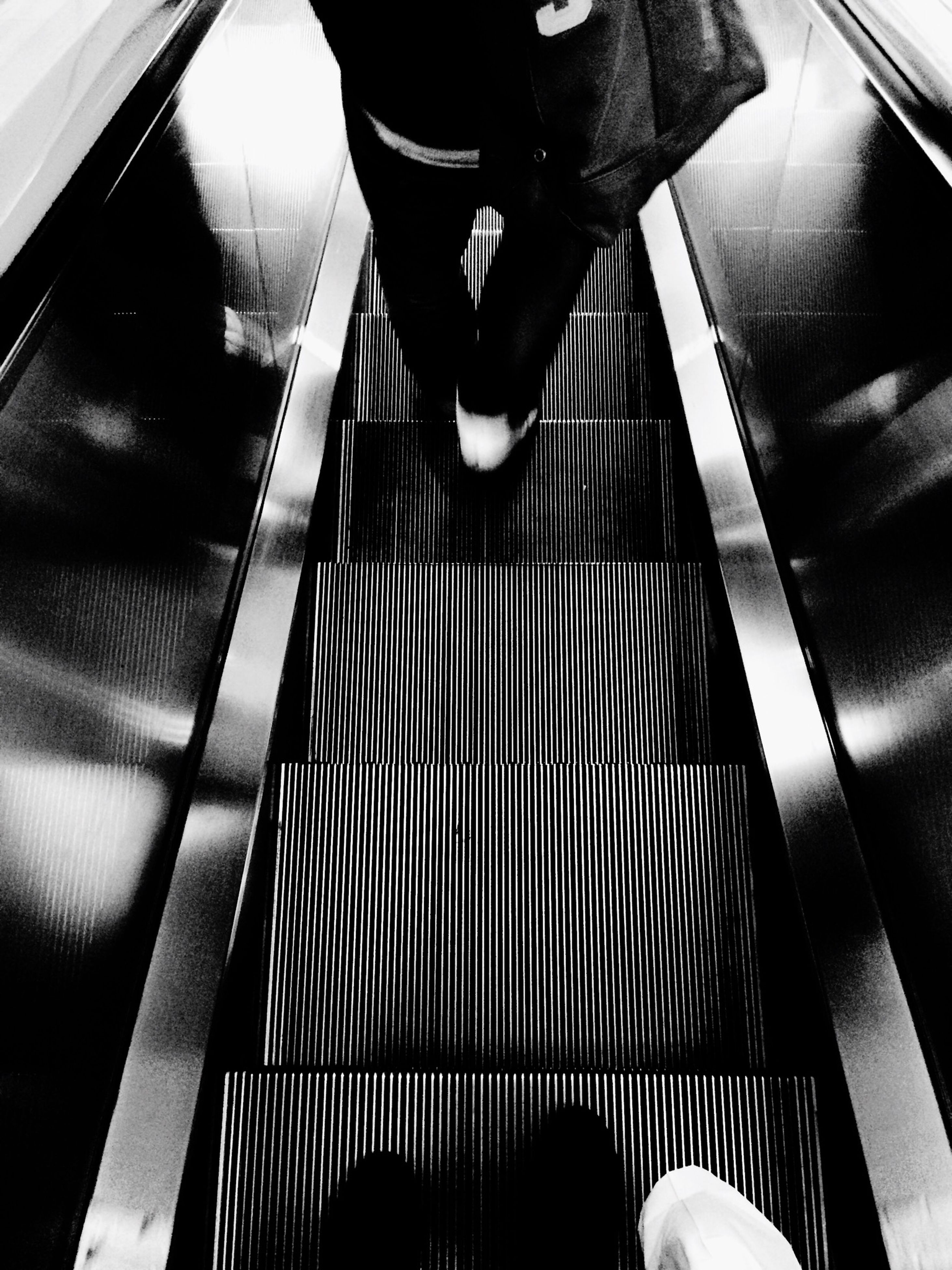 escalator, low section, indoors, steps, person, lifestyles, men, steps and staircases, staircase, railing, high angle view, standing, leisure activity, walking, modern, convenience