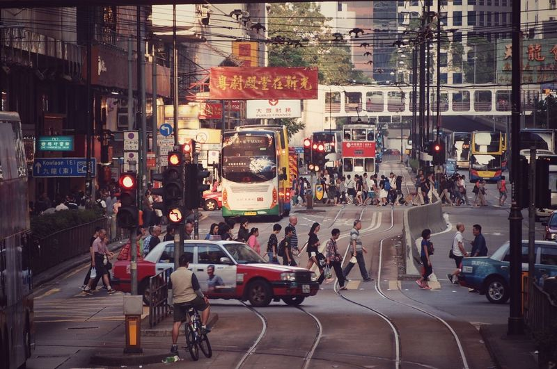 Street City Transportation Large Group Of People City Life Land Vehicle City Street Road Mode Of Transport Architecture Car Building Exterior Crowd Built Structure Men Real People Outdoors Cityscape Day People