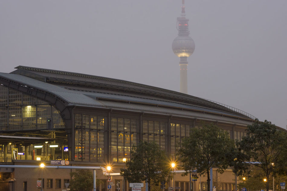 Friedrichstrasse Station at dusk with TV Tower in the background at a foggy day in Berlin, Germany Architecture Berlin Dusk Fog Friedrichstrasse Station Germany Hazy  Horizontal Illuminated Lit No People Photography Tv Tower Berlin Twilight