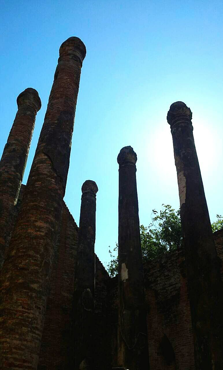 history, low angle view, industry, old ruin, architecture, architectural column, abandoned, built structure, ancient, no people, smoke stack, ancient civilization, outdoors, day, clear sky, sky