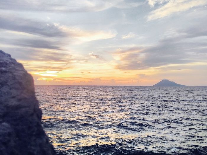 Sunset Sea Sky Sun Dramatic Sky Nature Cloud - Sky Beach Scenics Vacations Travel Destinations Water Sunlight Awe Manado - North Sulawesi, Indonesia. Beauty In Nature Mountain Nature