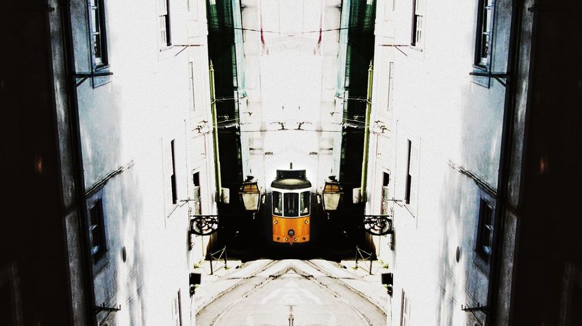 Photograph of a traditional transport in my city Lisbon, a Electric Train..edited my way mirror Architecture Building Exterior Built Structure City Day Electric Train House Mode Of Transport Old Outdoors Residential Building Residential Structure Street Transportation Urban Transportation Wall - Building Feature Window Yellow Train
