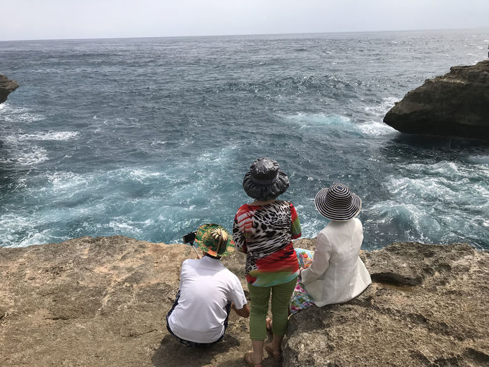 Bali, Indonesia Beach Beauty In Nature Day Friendship Full Length Horizon Over Water Leisure Activity Lembongan Island Lifestyles Men Nature Outdoors Real People Rear View Scenics Sea Sky Standing Water Wave Women