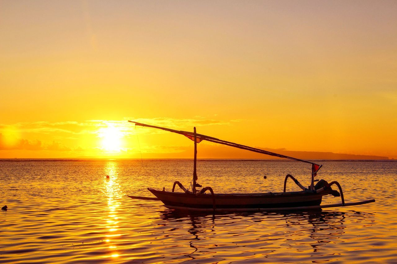 sunset, water, transportation, orange color, nautical vessel, mode of transport, beauty in nature, nature, sky, scenics, sea, silhouette, sun, waterfront, outdoors, longtail boat, tranquility, real people, yellow, outrigger, horizon over water, men, people
