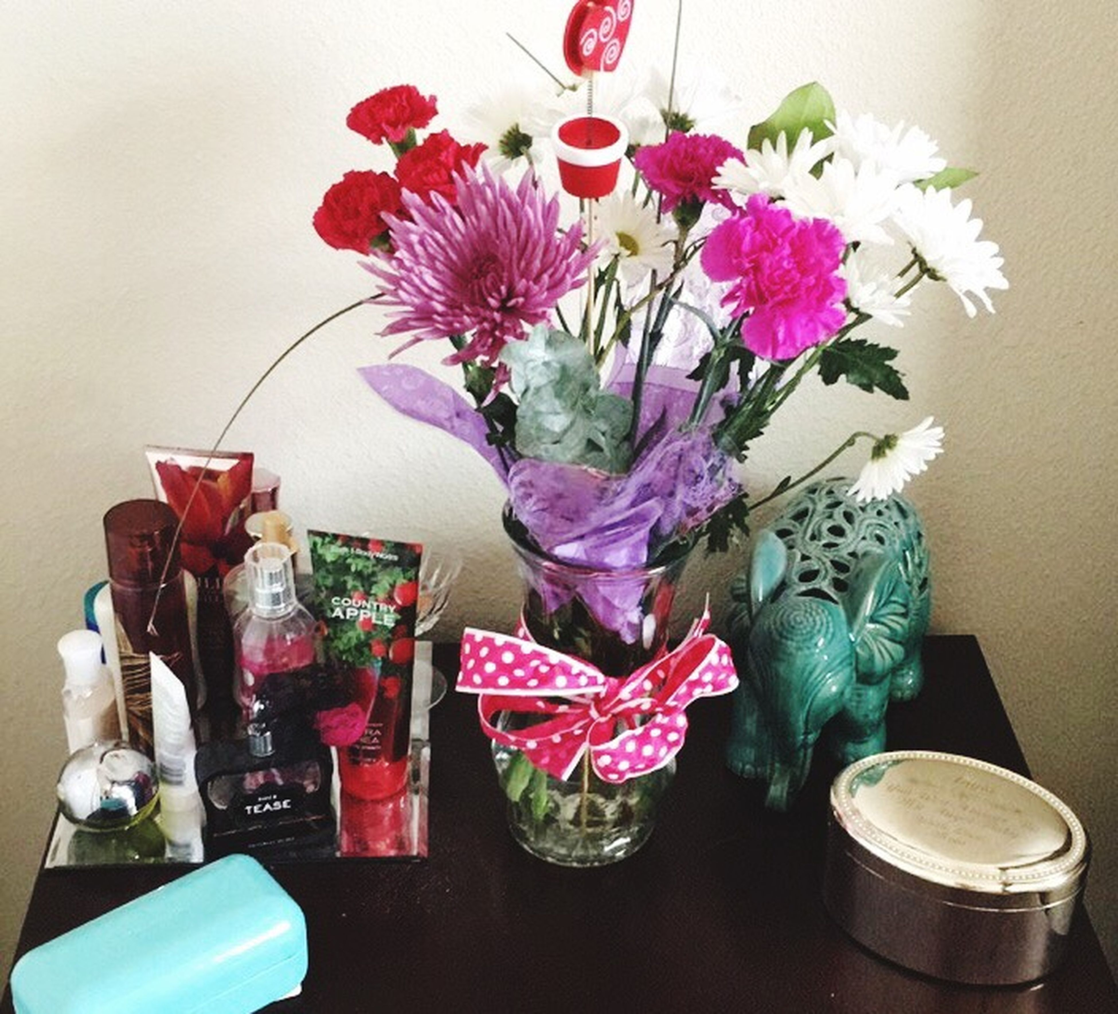 flower, indoors, vase, table, still life, freshness, flower arrangement, fragility, decoration, petal, home interior, glass - material, bouquet, bunch of flowers, flower head, close-up, wall - building feature, pink color, no people, bottle