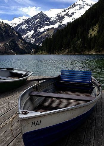 boats at lake in the alps, vilsalpsee Beauty In Nature Boat Forest Greenery Holiday Lake Moored Mountain Mountain Range Nature Nautical Vessel Outdoors Scenics Sky Snow Spring Tannheimer Tal Tranquil Scene Transportation Travel Vilsalpsee Water Wooden The Great Outdoors - 2017 EyeEm Awards Been There. Done That. Lost In The Landscape