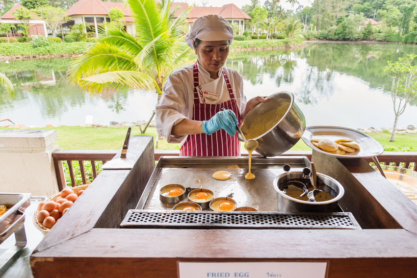 Trat, Thailand - May, 21, 2017 : Unidentified name woman chef was making pancake for breakfast at the restaurant of Klong Prao Resort in Koh Chang island Trat, Thailand. Adult Adults Only Day Editorial  Freshness Front View Hat Holding Illustrative Illustrative Editorial One Person One Woman Only One Young Woman Only Only Women Outdoors People Preparation  Standing Thailand Young Adult