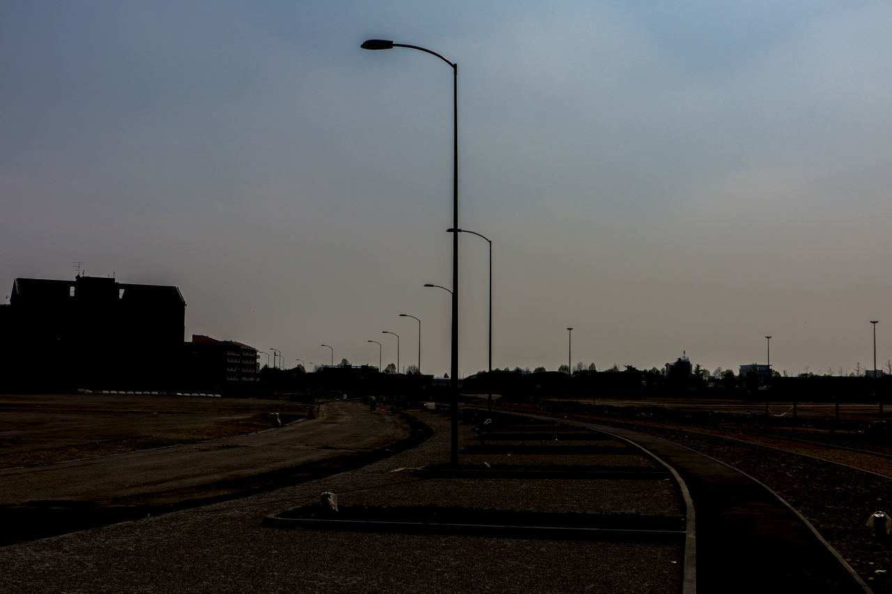 transportation, railroad track, rail transportation, sky, street light, no people, outdoors, the way forward, day, nature