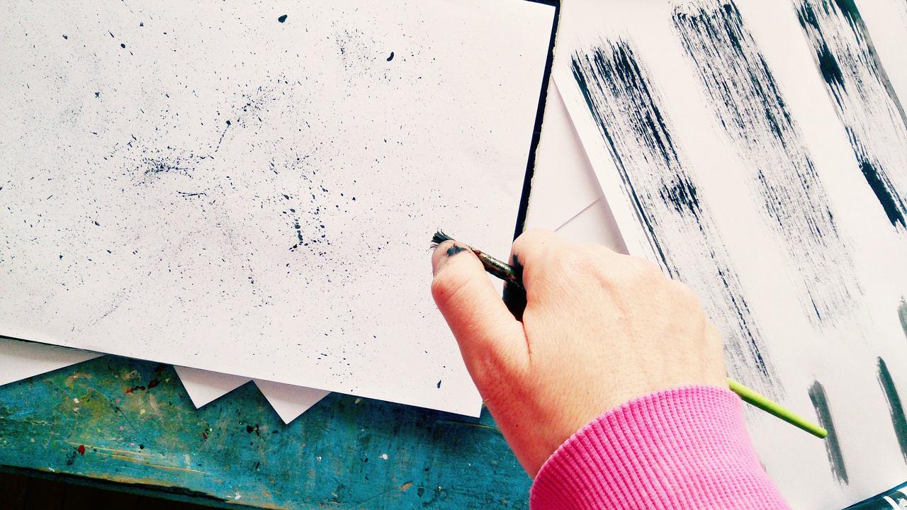 Hand holding a paint brush Abstract Art Art And Craft Artist Artist Artistic Black Bristles Brush Close-up Craft Creating Creative Creativity Decorate Experiment Holding Human Hand Paint Paintbrush Paper Splatter Spot Stain Texture
