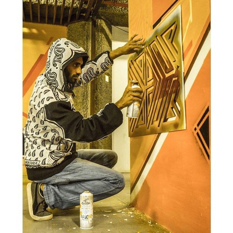 "A few weeks back, painting the Kenyatta International Convention Center, in Nairobi, Kenya. The ""symmetry in motion"" mural. Graffiti Streetart Wisetwo Graffuturism abstracts"