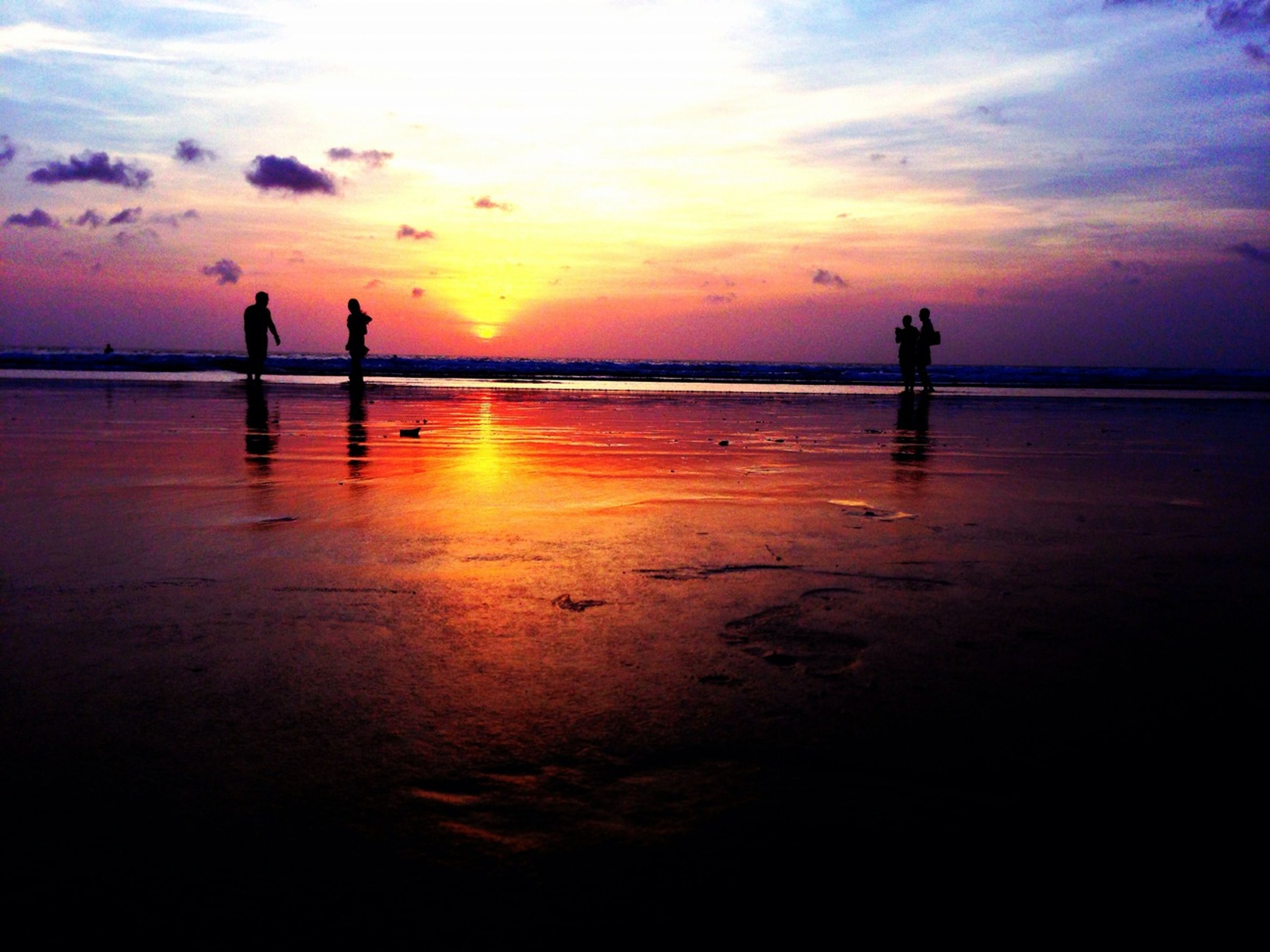 sunset, silhouette, beach, sea, water, horizon over water, shore, leisure activity, sky, lifestyles, scenics, orange color, men, beauty in nature, tranquil scene, tranquility, reflection, togetherness