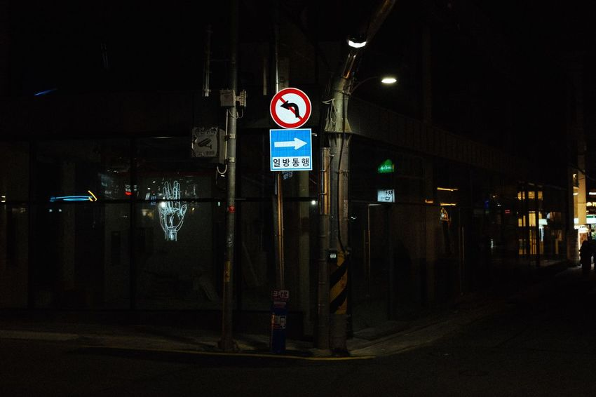 Illuminated Communication Night Transportation Human Representation Road Sign Guidance No People Architecture Built Structure Text Outdoors