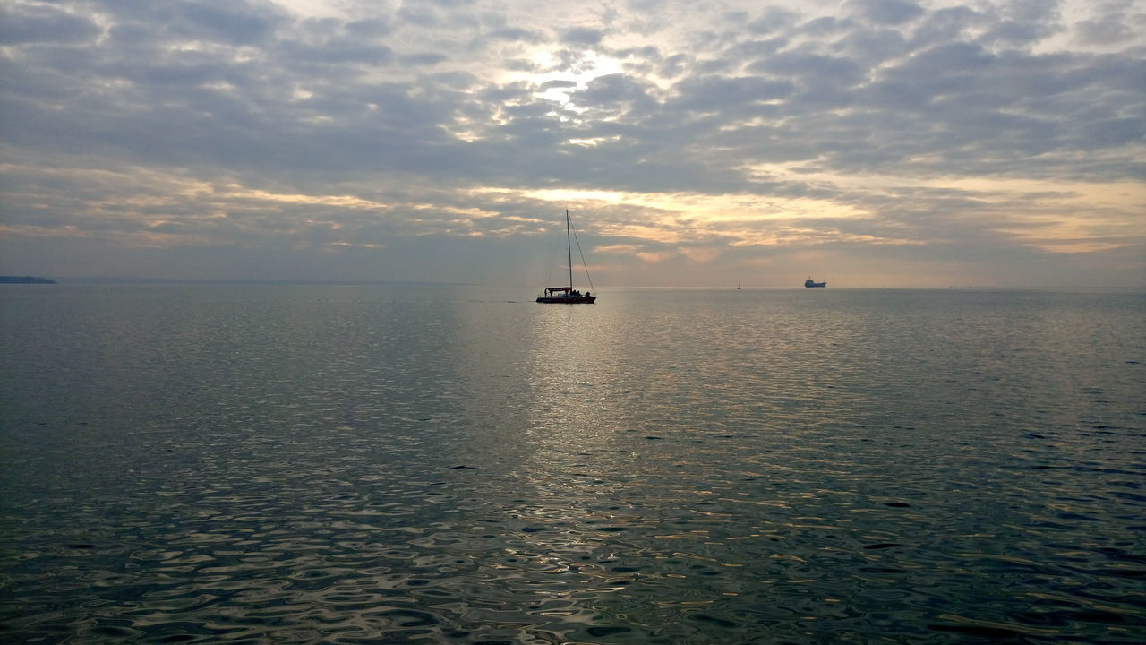 water, sea, sunset, sky, cloud - sky, nature, beauty in nature, tranquility, scenics, tranquil scene, horizon over water, no people, waterfront, transportation, mode of transport, outdoors, nautical vessel, day