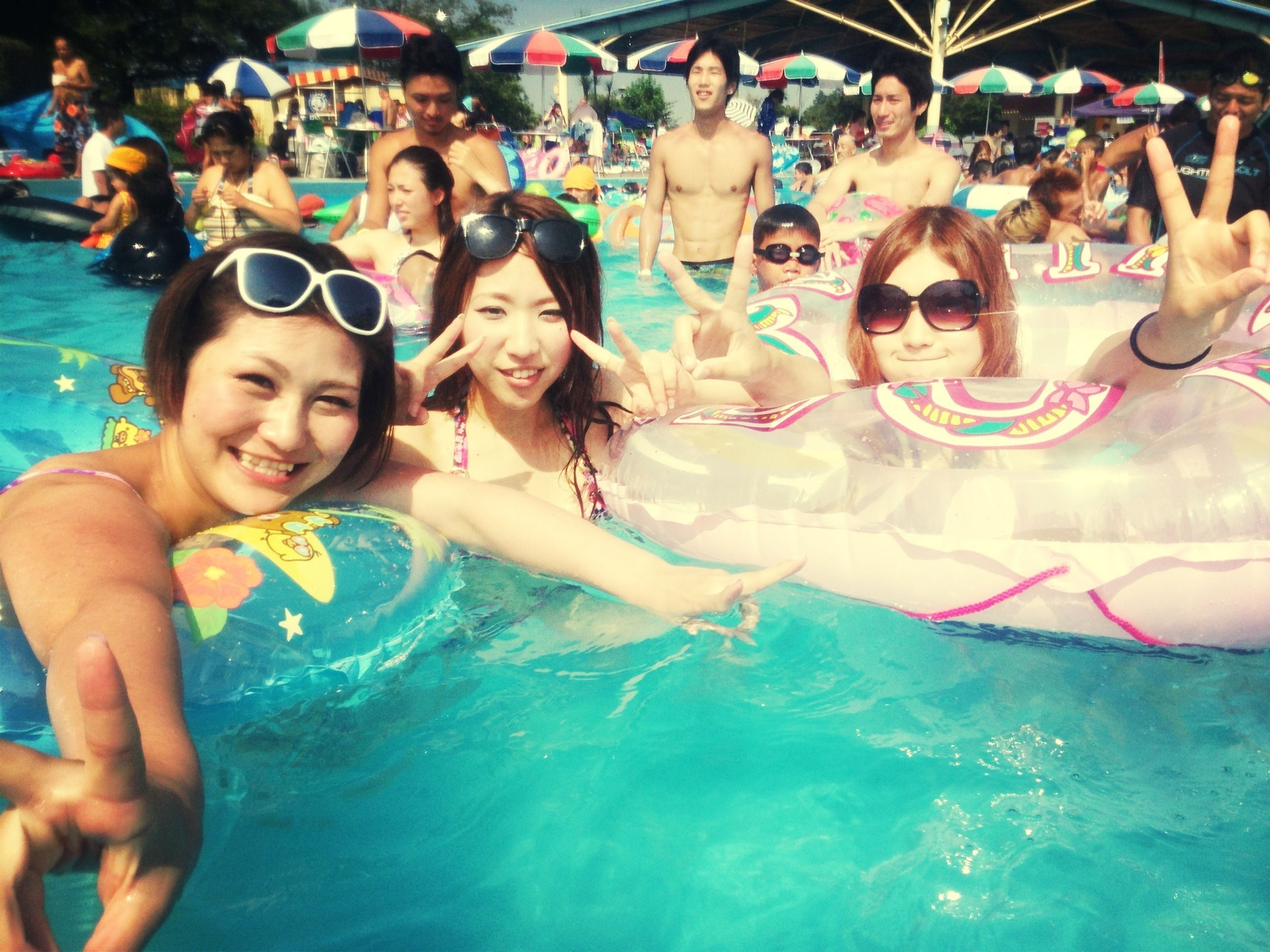 lifestyles, leisure activity, water, enjoyment, fun, togetherness, happiness, vacations, person, large group of people, friendship, sea, bonding, swimming pool, waterfront, enjoying, young women, smiling